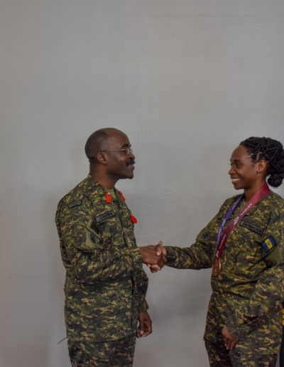 Chief of Staff Colonel Glyne Grannum congratulate Private Kimberley Gittens on her bronze medal win.
